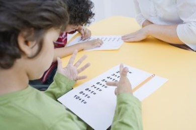 Children take tests frequently in the elementary classroom.