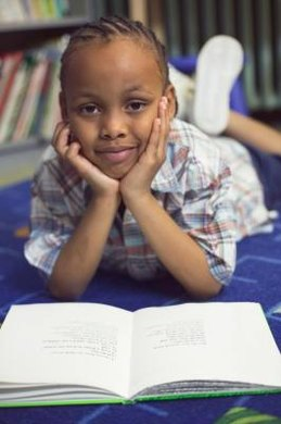 A child has to master several skills before reading independently