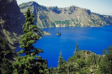 Tranquil lakes often adorn the tops of volcanic craters.