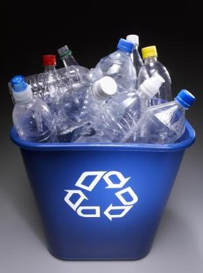 Recyclable plastics show the universal recycling symbol.