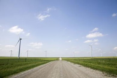 Wind turbines convert the wind's kinetic energy into mechanical energy and then to electricity.