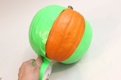 Cover the pumpkin with duck tape
