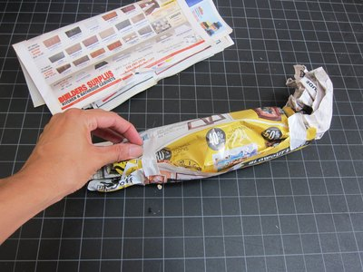 Make a roll out of newspaper.
