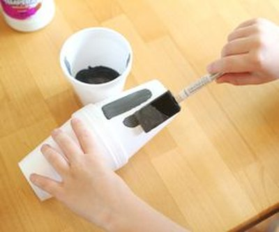 Apply gray paint to the cups using a sponge brush.