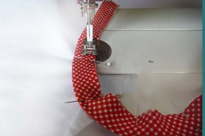 Sew the binding in place.