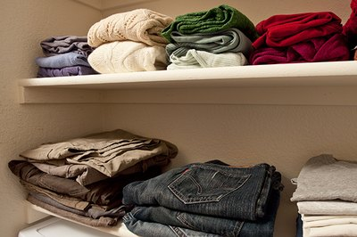 Stack clothing items and organize them by color on your new shelves.