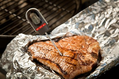 T-Bone steak with meat thermometer.