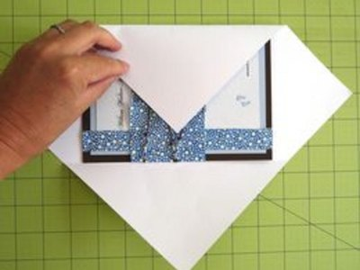 Fold the sides of the paper over the card.