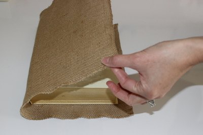 Fold burlap carefully, but as quickly as you can. Spray adhesive can get tacky fast.