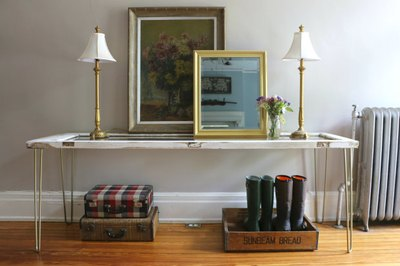 An antique door is repurposed into an elegant entry table.