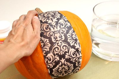 Place the wet paper on the pumpkin