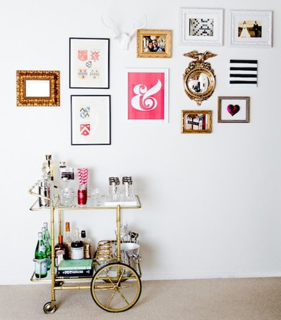 This antique bar cart is balanced by a gallery wall of modern prints.