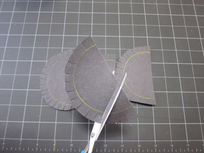Cut black semi-circles.