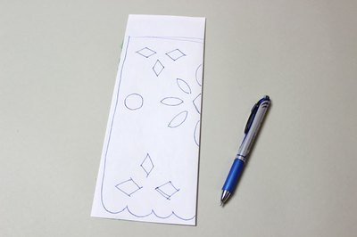 Fold the paper and draw your design