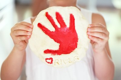 Clay handprints create charming keepsakes.