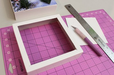 Cut an opening with a 1/2-inch border in the second lid.