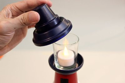 How to make a clay pot lighthouse with pictures ehow for Ikea tea light battery