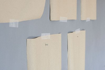 Add picture hanging nails right through the kraft paper.