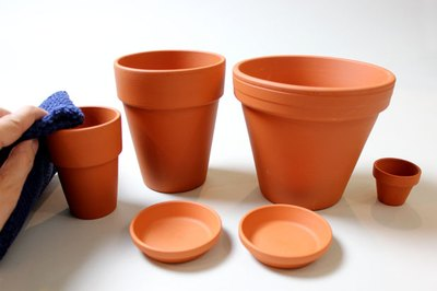 Wipe the clay pots with a damp cloth