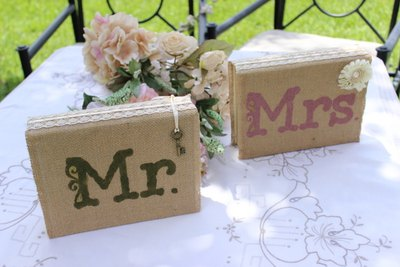 Mr. and Mrs. books wrapped in burlap as sweethearts table centerpiece.