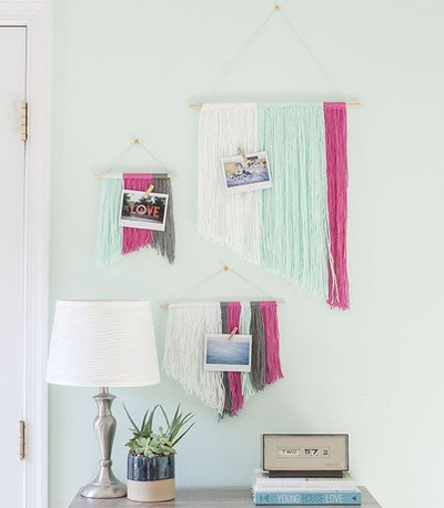 Make your own customizable wall art using yarn and wooden dowels.