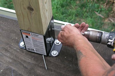 A hammer drill speeds the bolt installation.