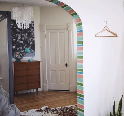 Washi tape adds color to an otherwise bland archway.