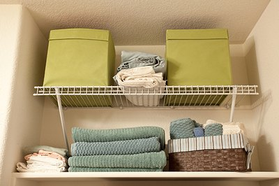 Fill shelves with items right up to the ceiling to maximize your closet storage.