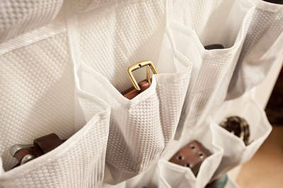 Don't limit your shoe rack to shoes only -- use the pockets to store small items like belts and jewelry.