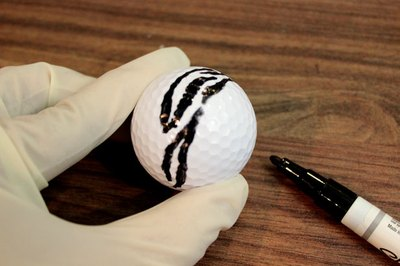Paint zebra stripes on the golf ball