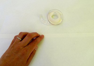 Attach two sheets of freezer paper.