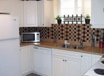 Adhere backsplash materials to a portable board instead of on the actual wall.