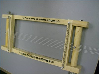 Line up the strings so that they are straight on the loom before tightening.