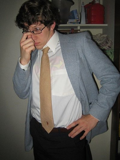 Dressed as Clark Kent with a suit