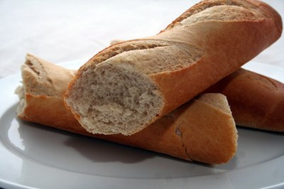 The long baguette is crusty on the outside and soft white on the inside.