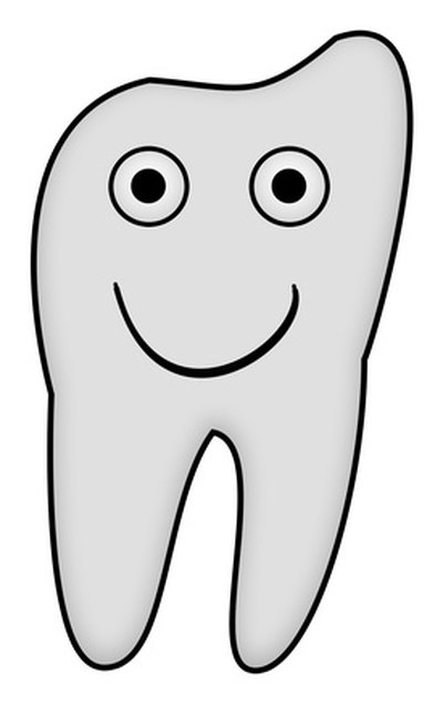 A digital image of a tooth provides reference when drawing the design on poster board.
