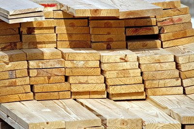 Determine lumber needs for the walls, including whether to use planks, sheets of plywood or tin.