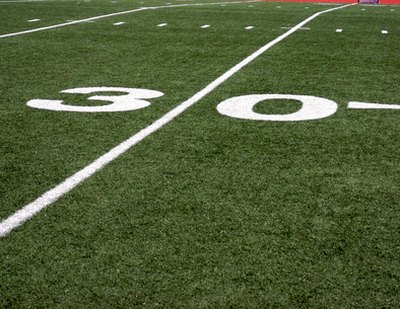 Numbers appear on either side of the yard line.