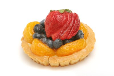 The shine on a French fruit tart is created by a clear glace.