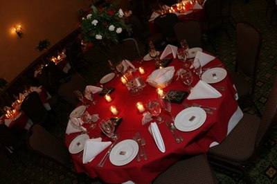 Use inexpensive white crockery from a discount store  to set a festive, winter table.