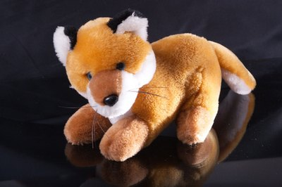 Using stuffed animals in the shapes of a fox and a hen makes the game more concrete to three-year-olds.