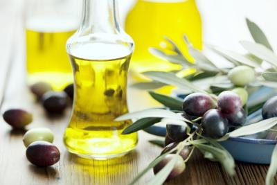 Olive oil on table with olives