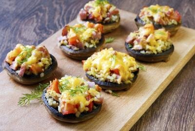 Stuffed mushrooms on a wooden tray