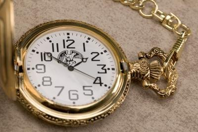 Gold pocket watch.