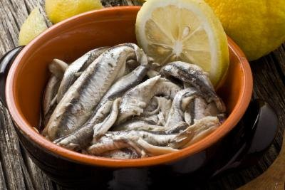 Anchovies with olive oil and lemon in a bowl