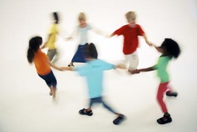 Children dancing in a circle.