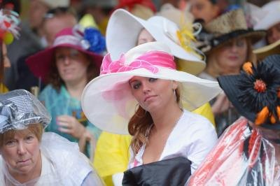 Women wearing elaborate hats at the 139th Kentucky Derby, 2013