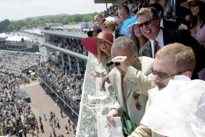 The Crowds and celebrities at Churchill Downs watching the Kentucky Derby race