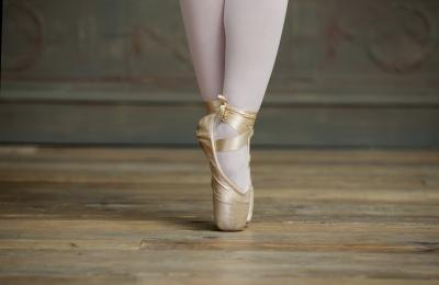 Teen girl in ballerina outfit.