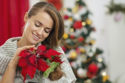 Choose a flower arrangement that is both Christmas-like and includes flowers that the recipient likes.